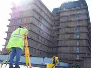 Land Surveyor surveying a tower block